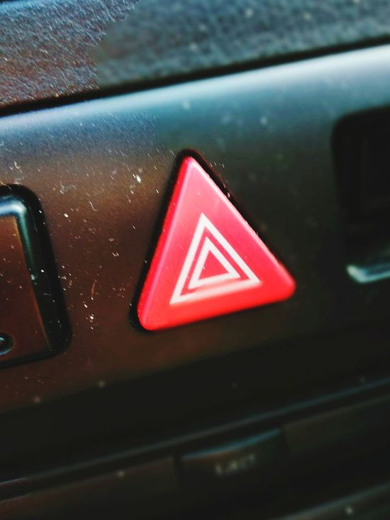 Safety Red Danger Triangle Shape Warning Sign Communication Close-up No People Indoors  Road Sign Technology Day Rethink Things Symbolism Is Everything Symbology Hazardous Hazard Uber