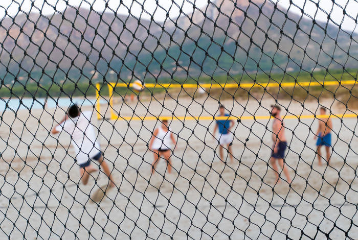 Beach Beach Volleyball Competition Competitive Sport Day Friendship Full Length Leisure Activity Lifestyles Mountains Net - Sports Equipment Outdoors Playing Playing Field Practicing Real People Soccer Son Serra De Marina Sport Sports Team Sportsman Team Sport Teamwork Togetherness Volleyball