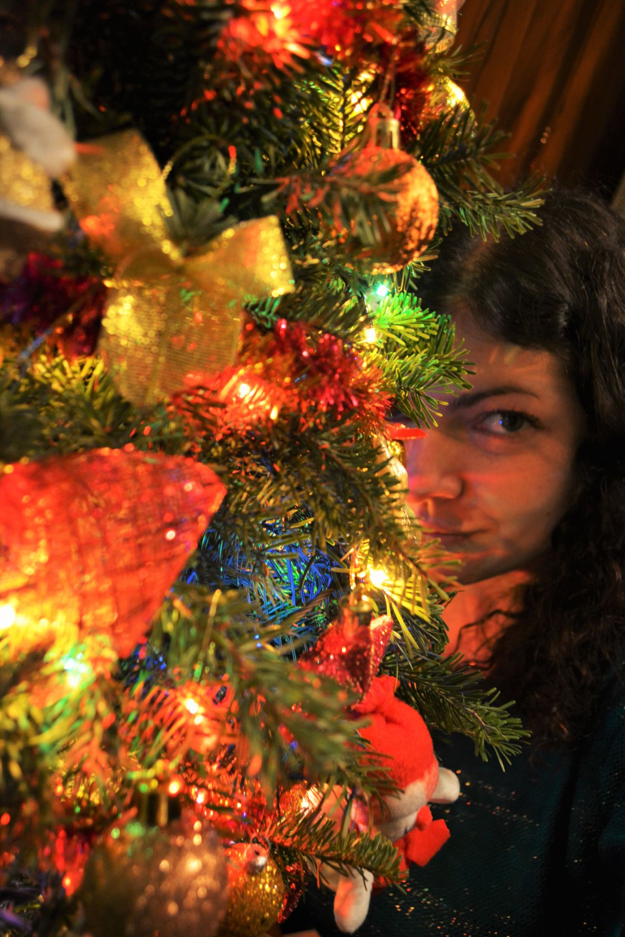 Celebration Childhood Christmas Christmas Decoration Christmas Ornament Christmas Tree Close-up Happiness Holiday - Event Illuminated Indoors  Lifestyles Looking At Camera Night One Person People Portrait Real People Smiling Tradition Tree Young Adult