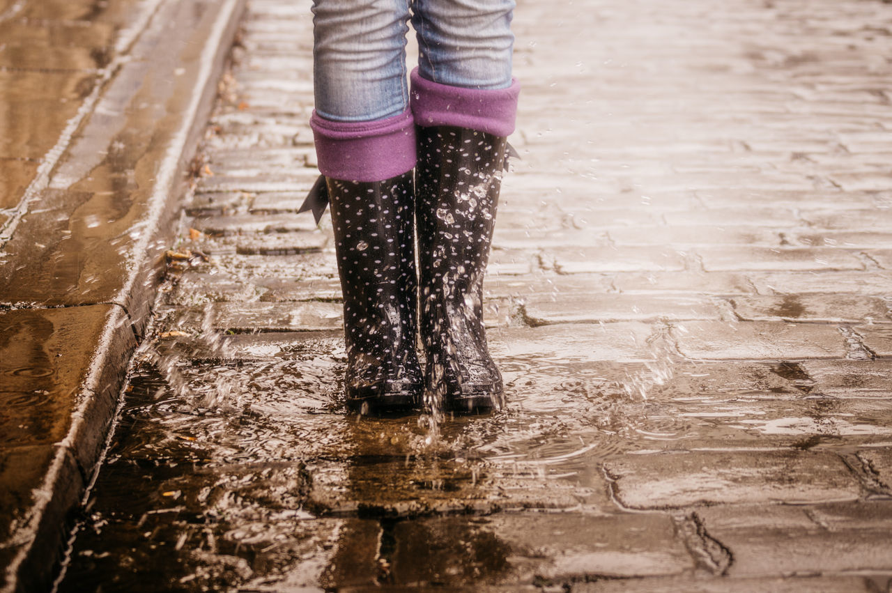 Make a splash! City Gumboots Human Leg Jeans Low Section One Person One Woman Only Outdoors People Puddle Rain Rain Boots Rubber Boots Splash Standing Street Water Wellington Boots