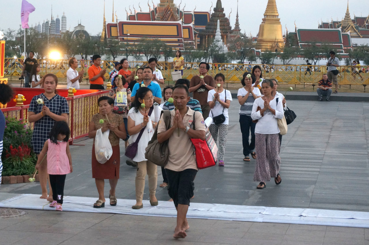 Buddhists making merit in Magha puja day in Bangkok 2016 Bangkok Buddhism Buddhist Casual Clothing Front View Lifestyles Makhabucha Merit Merit-making Real People Street Photography Streetphotography Temple Thailand Spotted In Thailand