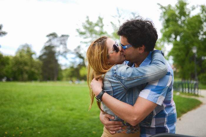 Affectionate Arm Around Bonding Casual Clothing Couple - Relationship Day Embracing Focus On Foreground Grass Happiness Kissing Leisure Activity Lifestyles Love Outdoors Piggyback Real People Romance Smiling Standing The Portraitist - 2017 EyeEm Awards Togetherness Two People Young Adult Young Women
