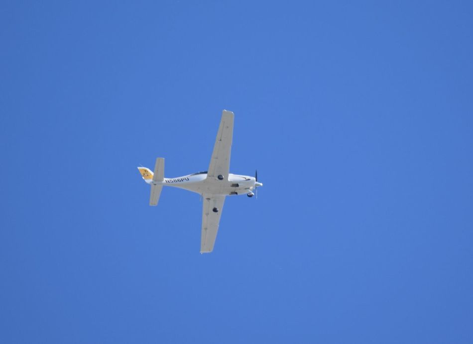Purdue University Cirrus SR-20 (N586PU) Aerospace Industry Air Force Air Vehicle Airplane Airshow Blue Clear Sky Day Fighter Plane Flying Low Angle View Military Military Airplane No People Outdoors Plane Sky Transportation