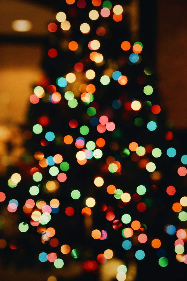 The Culture Of The Holidays Xmas Xmas Tree Christmas Tree Christmastime Christmas Day Glowing Lens Flare Bokeh Bokeh Photography Bokehlicious Vibrant Color Light Blurred Motion Bright Defocused Defocused Illuminated Glowing Lens Flare Multi Colored