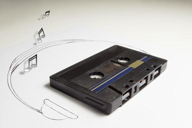 Audiotape and headphone draw on white background Audio Cassette Compact Cassette Draw Earphones Headphones Listen Music Phones Retro Shape Sound Tape Technology Vintage