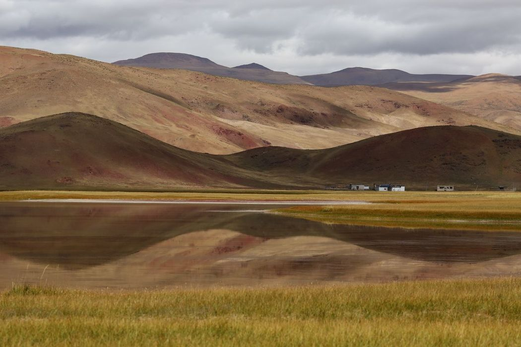 reflection of a remote lake in Tibet. Beauty In Nature Grass Lake Landscape Mountain Nature Outdoors Reflection Remote Location Scenics Tibet Tranquil Scene