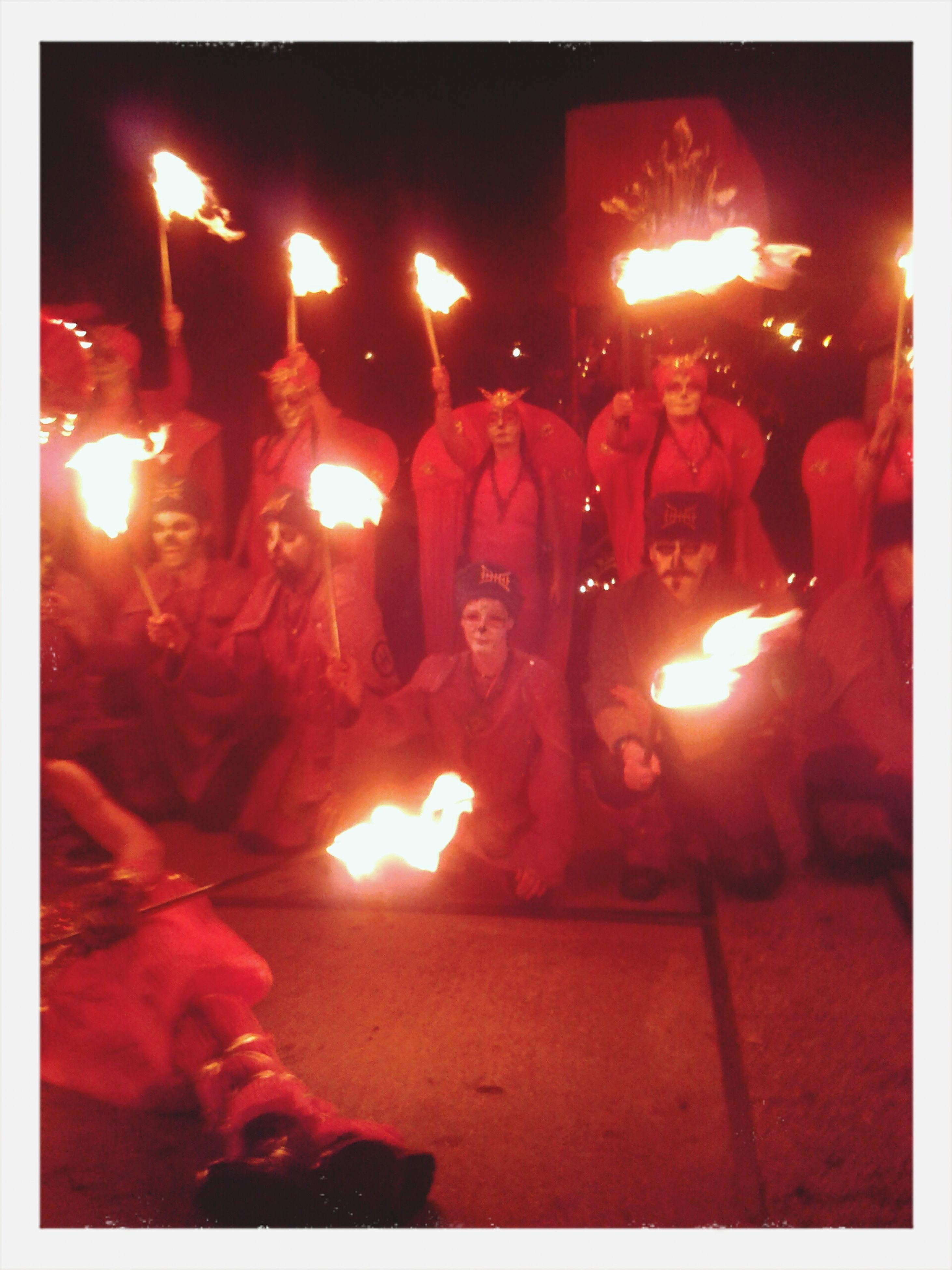 transfer print, illuminated, night, lifestyles, large group of people, burning, men, leisure activity, flame, togetherness, celebration, enjoyment, auto post production filter, fire - natural phenomenon, glowing, event, person, fun, heat - temperature