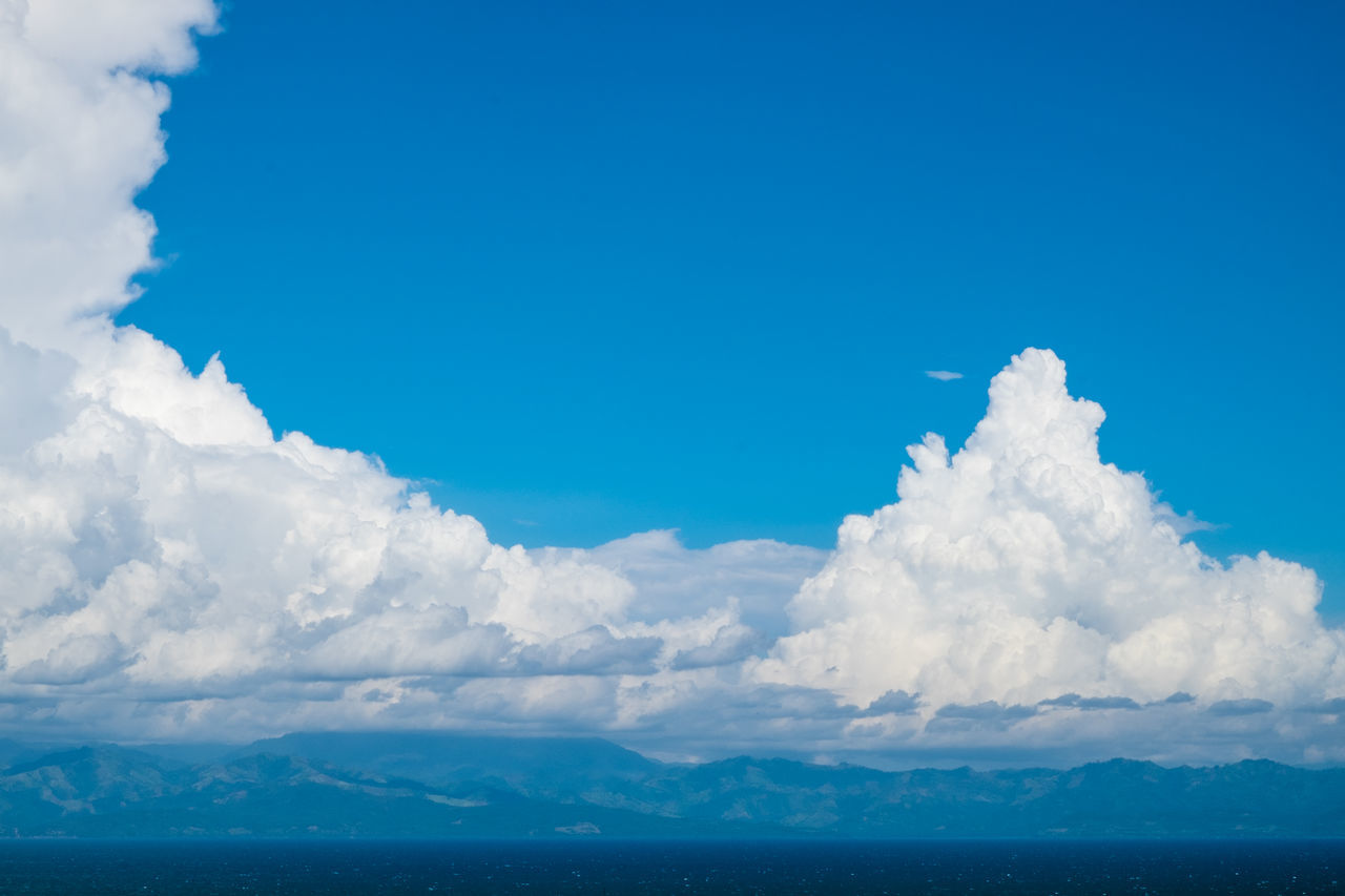 Beauty In Nature Blue Blue Sky Bright Cloud - Sky Copy Space Cumulus Day Fluffy Horizon Mountain Range Nature Outdoors Philippines Scenics Sea Sky Stratocumulus Sunny Tranquil Scene Tranquility Water