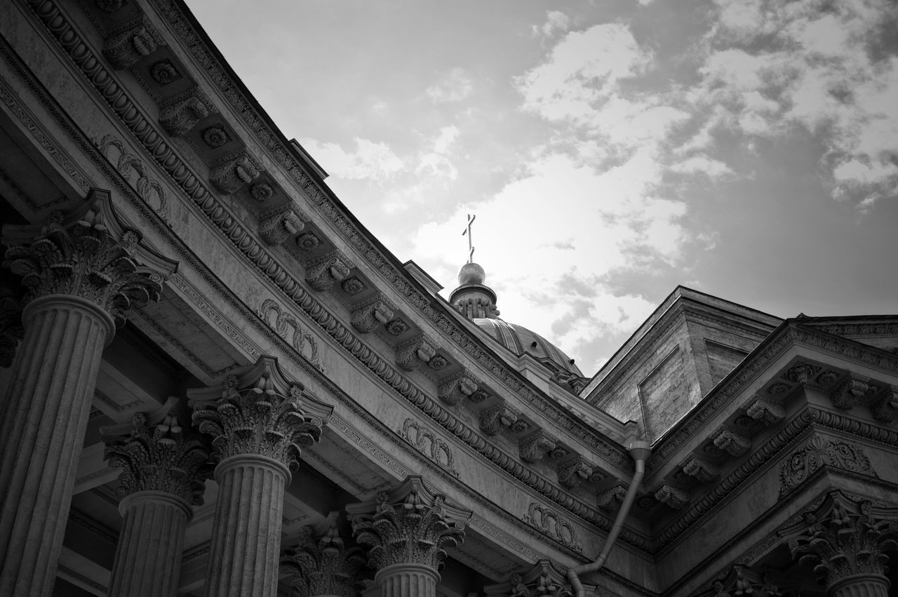 architecture, low angle view, built structure, building exterior, sky, architectural column, history, outdoors, cloud - sky, day, statue, travel destinations, no people, sculpture