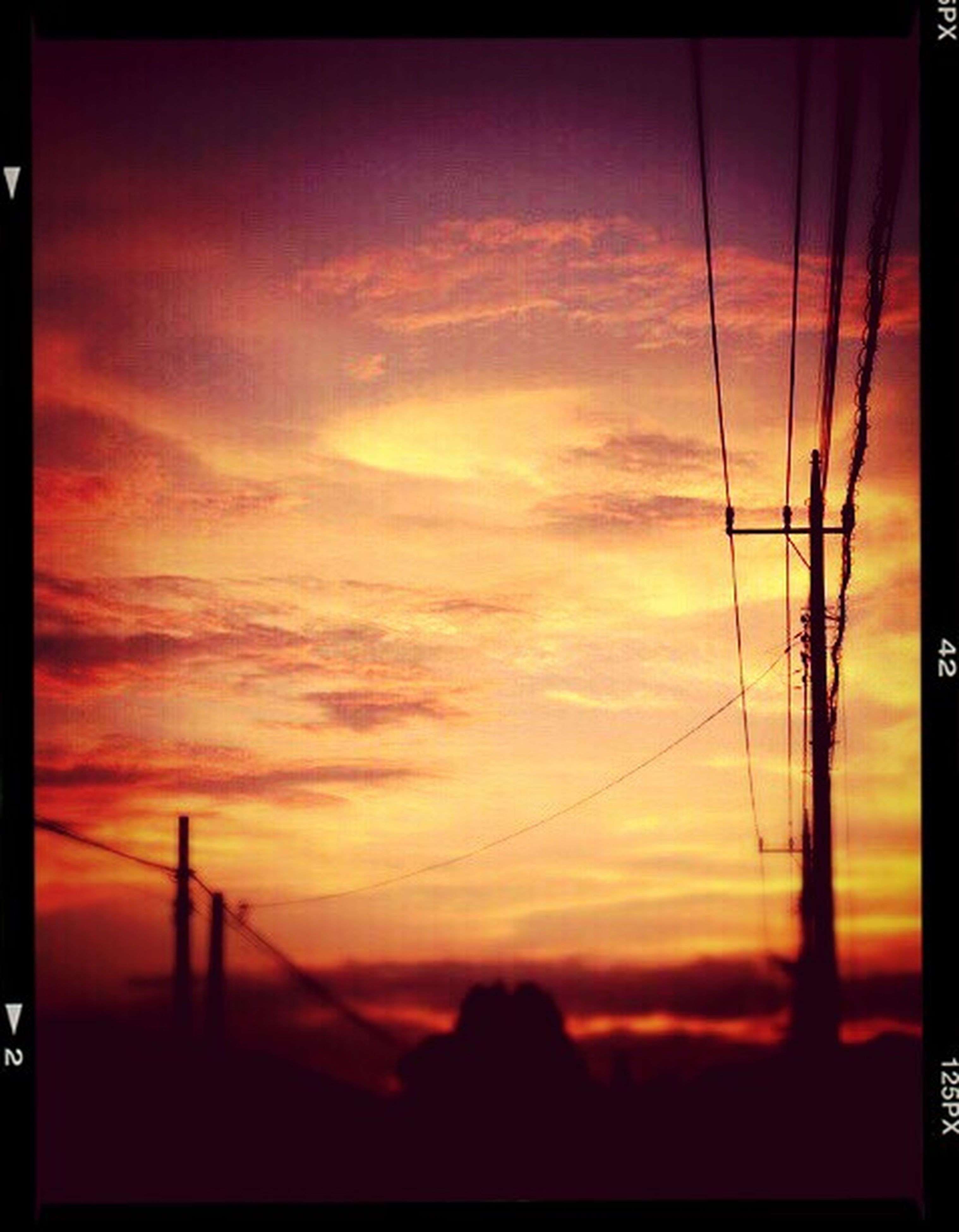 sunset, silhouette, power line, sky, electricity pylon, power supply, orange color, transfer print, connection, low angle view, electricity, built structure, fuel and power generation, architecture, building exterior, cloud - sky, auto post production filter, technology, cable, dusk