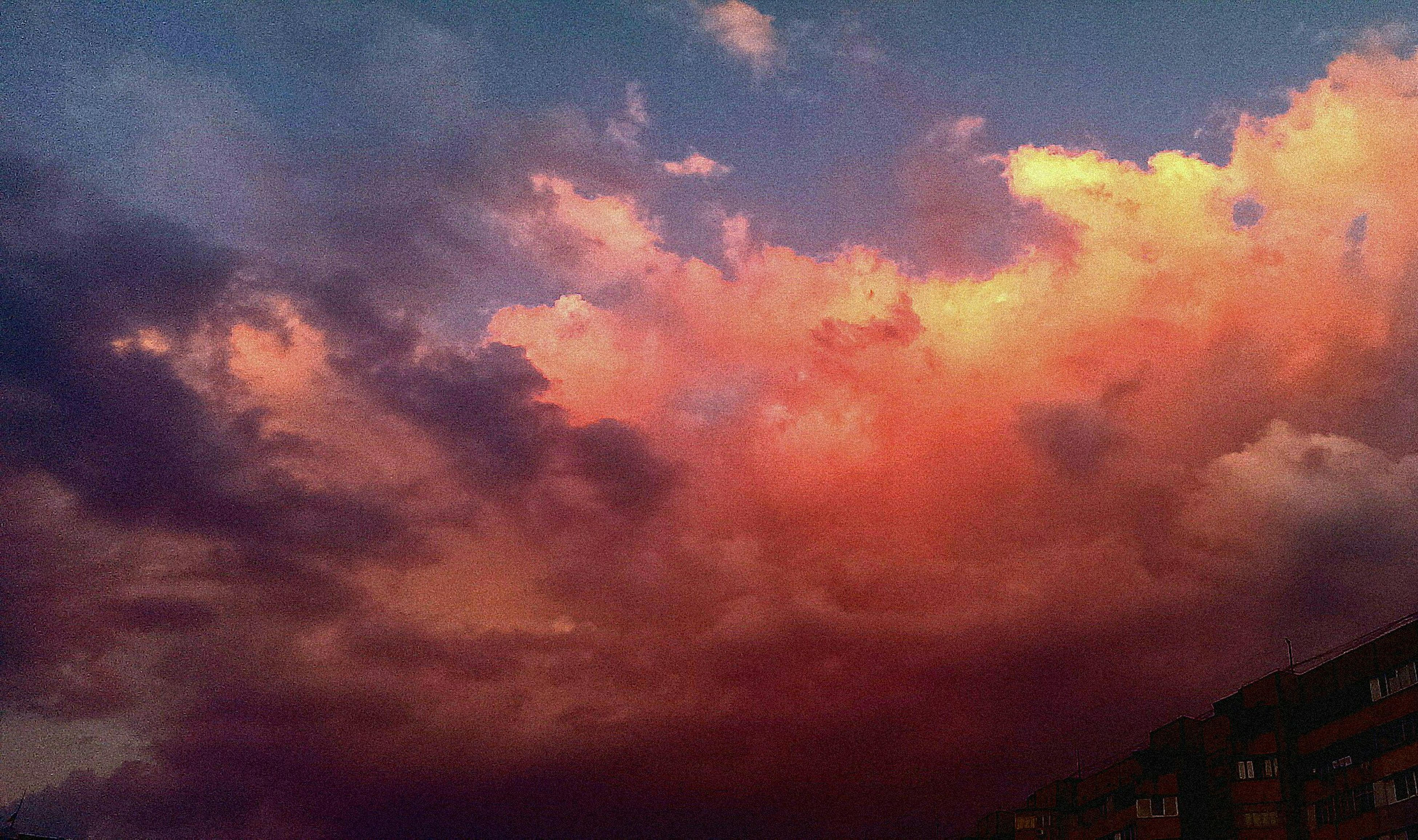 sky, cloud - sky, sunset, low angle view, cloudy, beauty in nature, scenics, dramatic sky, tranquility, orange color, weather, nature, silhouette, tranquil scene, overcast, cloud, idyllic, cloudscape, dusk, outdoors