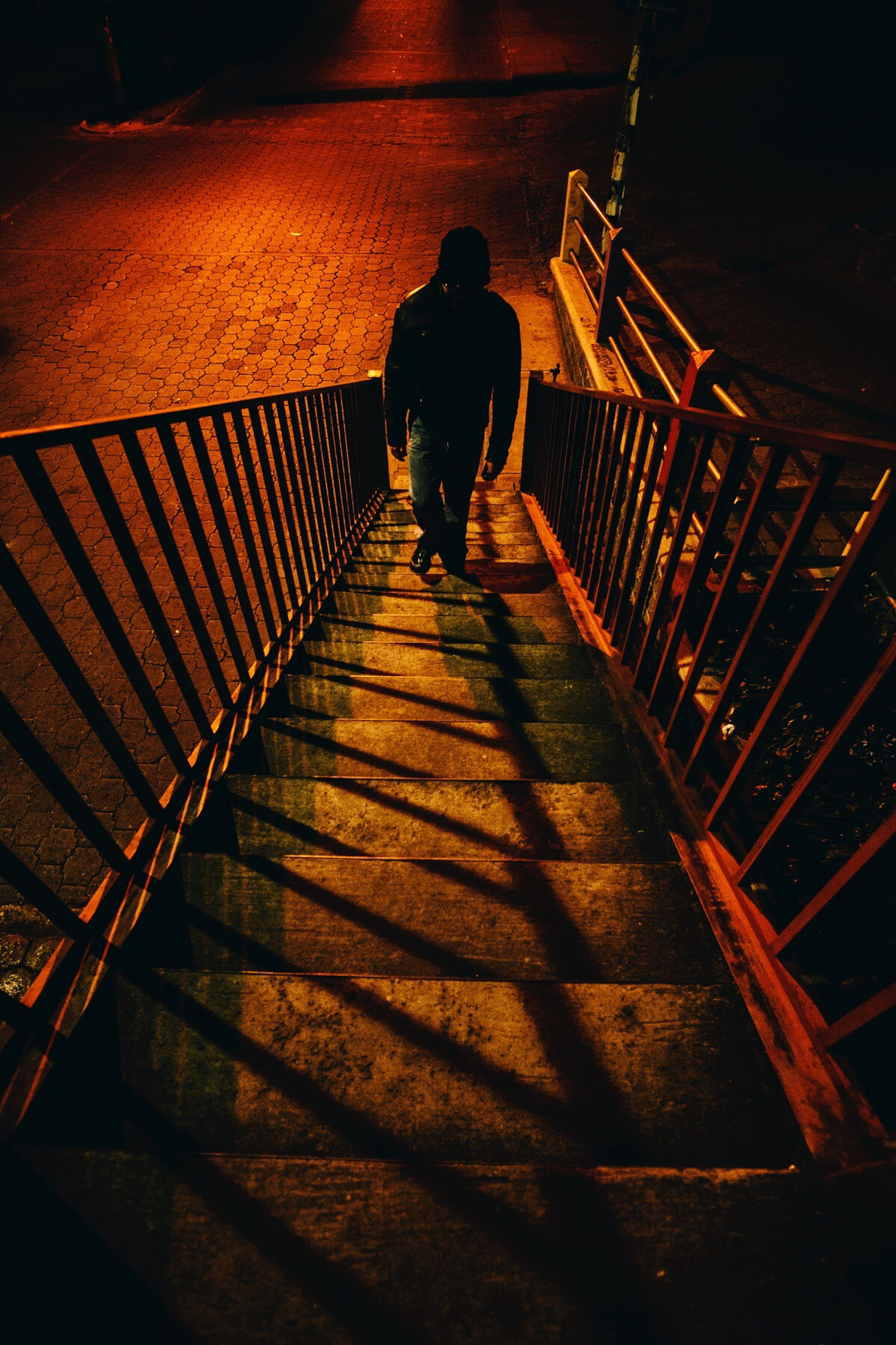 full length, lifestyles, walking, railing, men, rear view, steps, the way forward, silhouette, steps and staircases, leisure activity, staircase, togetherness, person, shadow, indoors, standing