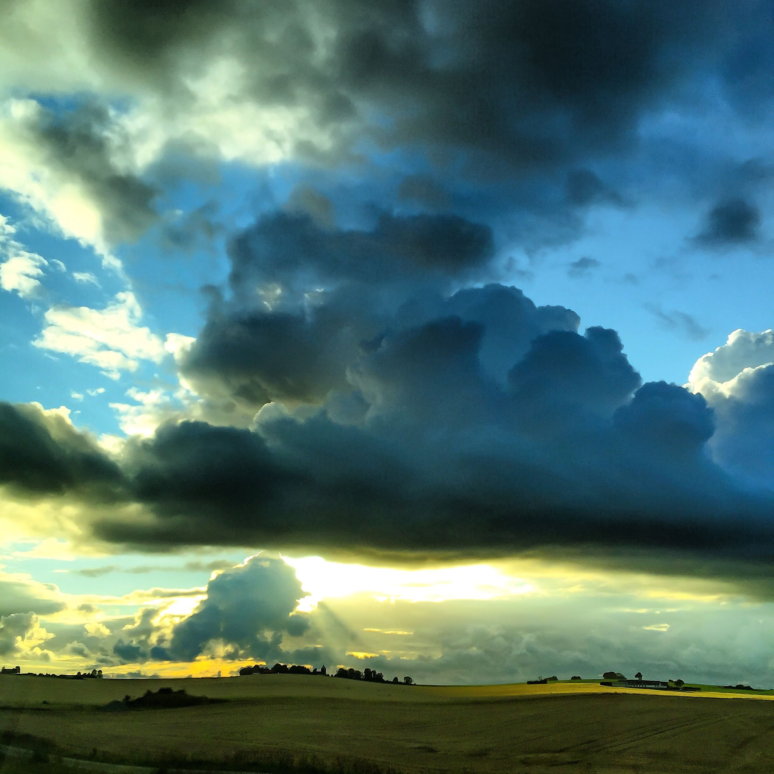 sky, cloud - sky, landscape, cloudy, scenics, tranquil scene, beauty in nature, tranquility, dramatic sky, weather, nature, storm cloud, field, cloud, overcast, cloudscape, sunset, idyllic, atmospheric mood, horizon over land