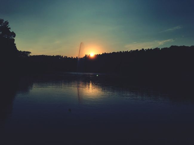 Nothing Better than piece and quiet Silhouette Lake Water Tranquil Scene Sunset Reflection Tranquility Scenics Waterfront Calm Dark Nature Sun Sky Majestic Beauty In Nature Cloud Orange Color Outline Outdoors Nature EyeEm EyeEm Nature Lover