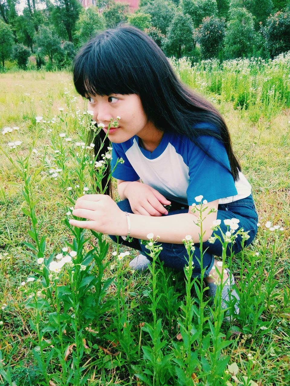 real people, field, one person, outdoors, growth, grass, nature, green color, young women, day, tree, young adult, beautiful woman, flower, human hand