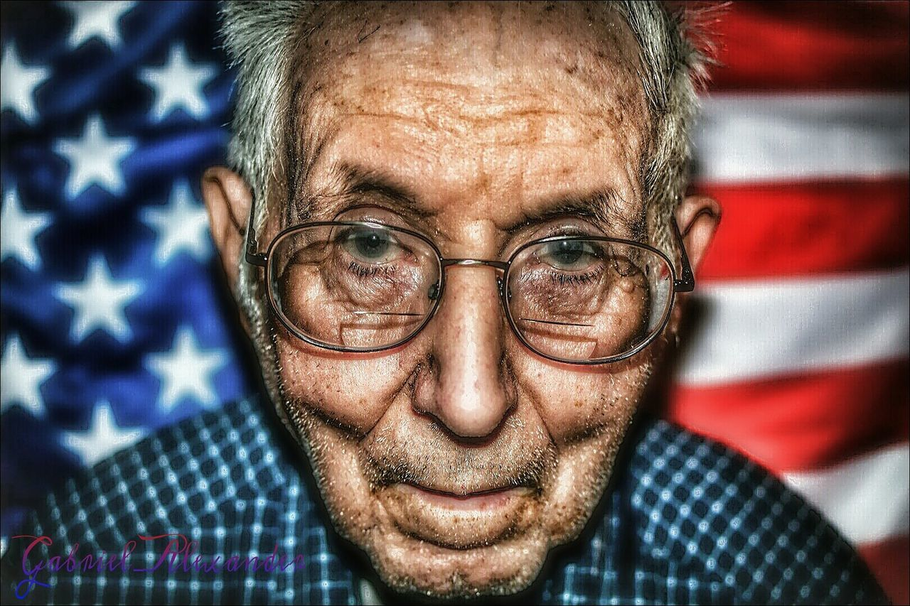 eyeglasses, senior adult, portrait, looking at camera, real people, human face, one person, headshot, close-up, front view, senior men, indoors, lifestyles, one senior man only, human body part, one man only, day, only men, adult, adults only, people