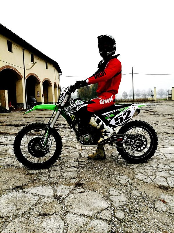 Bicycle One Person Cycling Riding Transportation Adults Only Full Length One Man Only Only Men People Crash Helmet Cycling Helmet Headwear Travel Destinations Sky Young Adult Sport Adventure Helmet Outdoors Italy Photos Motocross Motocross Community Motocross In Action Kawasaki
