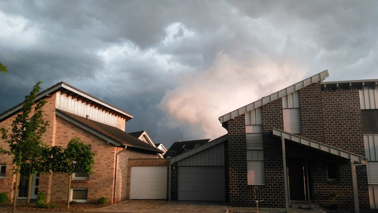 built structure, building exterior, architecture, cloud - sky, sky, house, weather, outdoors, no people, storm cloud, tree, day, residential building, nature, city