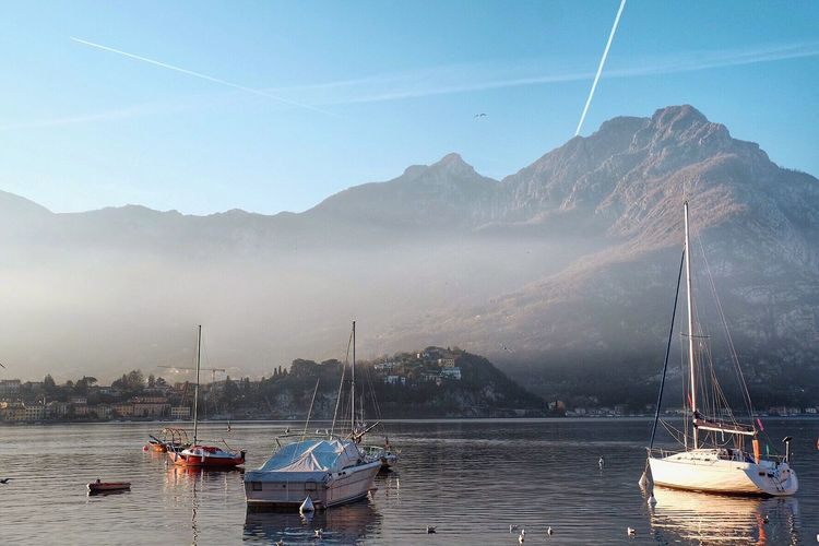 Mountain Mountain Range Mode Of Transport Nautical Vessel Transportation Sky Scenics Water Beauty In Nature Nature Moored Boat Outdoors Waterfront Tranquil Scene No People Sailboat Connection Fog Foggy Morning Lecco Lake Lecco Italia Italy Europe