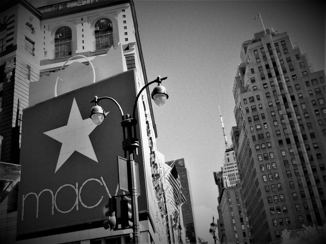 A Black and White photo shot of Macys New York. Architecture BIG Big Signs Black And White Building Exterior Built Structure City Clear Sky Communication Day Guidance Logo Low Angle View New York New York City New York City USA No People NYC NYC Street Outdoors Road Sign Signs Sky Skycrapers Skyscrapers