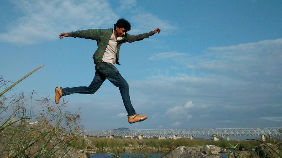Beautiful stock photos of jump, Arms Outstretched, Asian And Indian Ethnicities, Bridge - Man Made Structure, Built Structure
