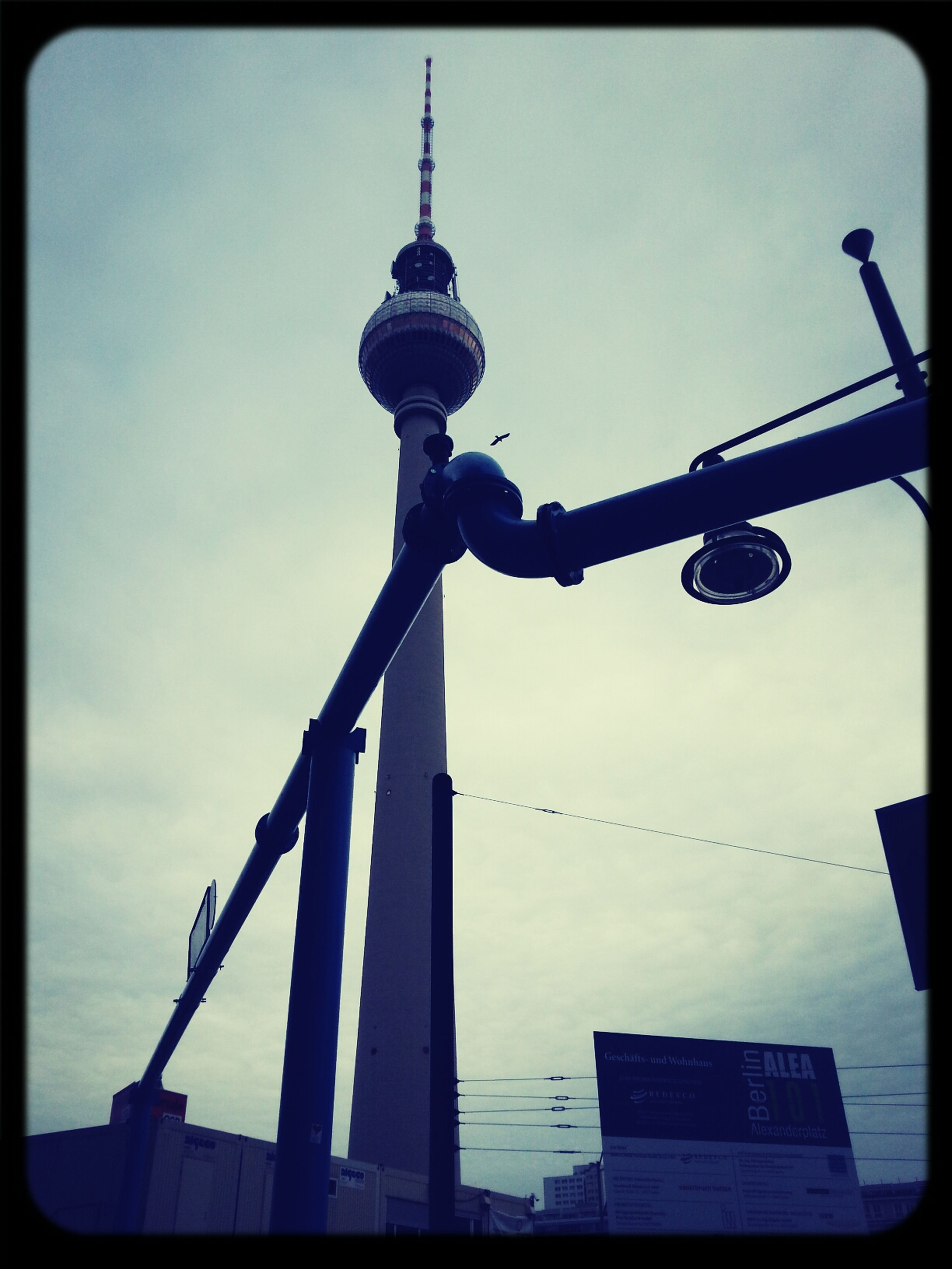 transfer print, communications tower, tower, communication, low angle view, architecture, built structure, tall - high, auto post production filter, sky, building exterior, fernsehturm, television tower, spire, travel destinations, international landmark, culture, capital cities, sphere, famous place