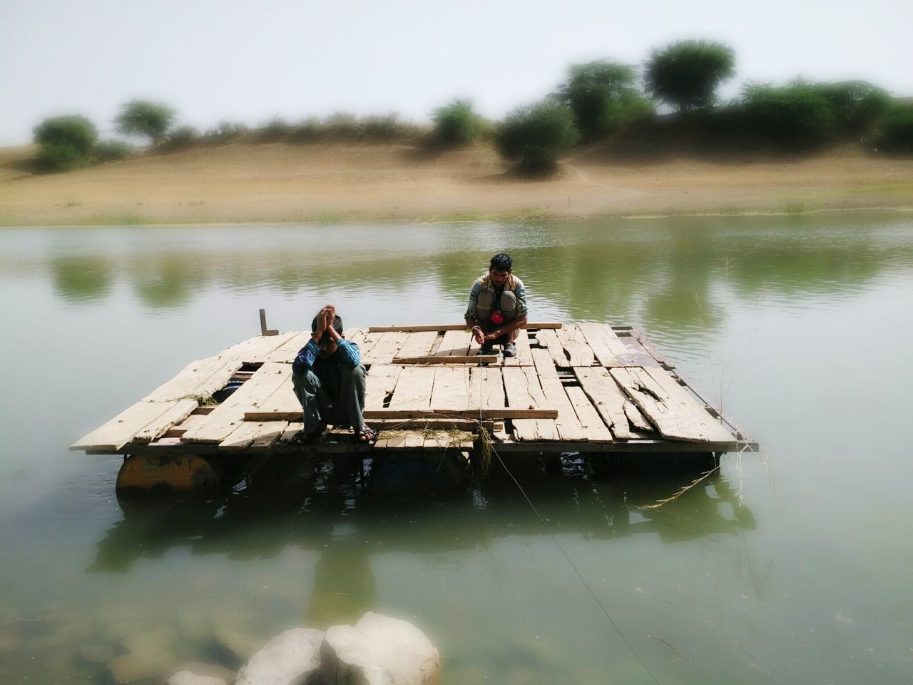 Two villagers crossing the river with self made boat Jugad Nature India River Green