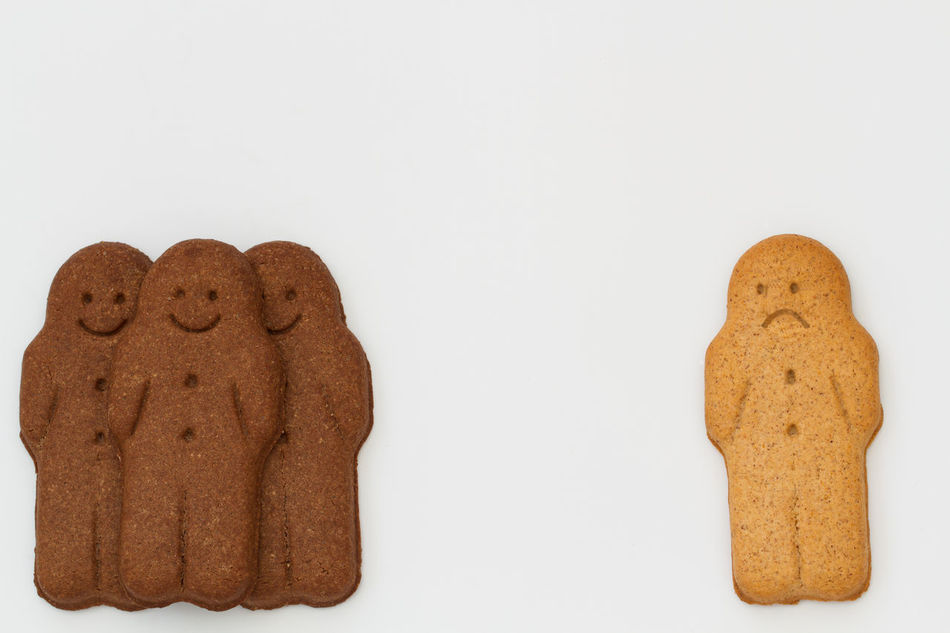 Black and white, happy and smiling gingerbread men representing racial diversity and equality on a white background. Baking Blackandwhite Colours Cookie Cookies Diverse Diversity Friends Friendship Gingerbread Gingerbread Cookie Gingerbread Man Happy Inequality Integration Outcast Race Racial Diversity Racial Inequality Racialharmony Racism Segregation  Together Togetherness White Background