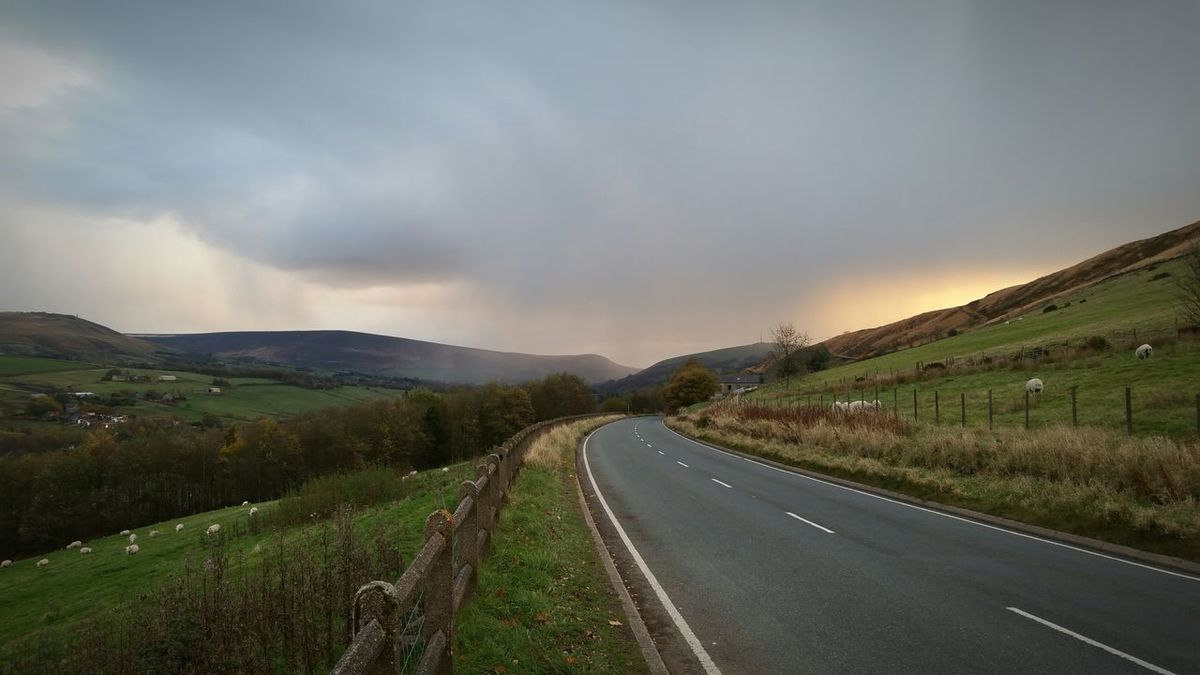 Lonely road, clouds and squall Road Winding Road Highway Landscape Clouds Storm Approaching Rain Sheep Sun Through The Clouds No People No Vehicles Yorkshire
