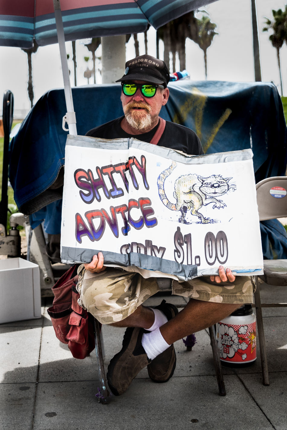 Getting some shitty advice, Venice Beach, Los Angeles Advice Beach Beach Life Beach Umbrella Busker Character Day Earning A Living Funny La Los Angeles, California Los Ángeles Person Shitty Day Sign Street Photography Sunglasses Travel Photography USA Venice Beach