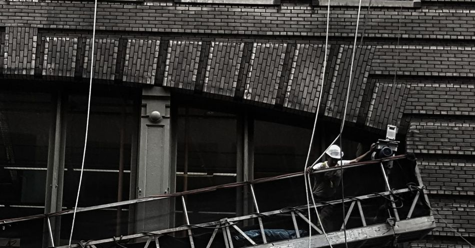 The hard working man works on a hot day in New York City.