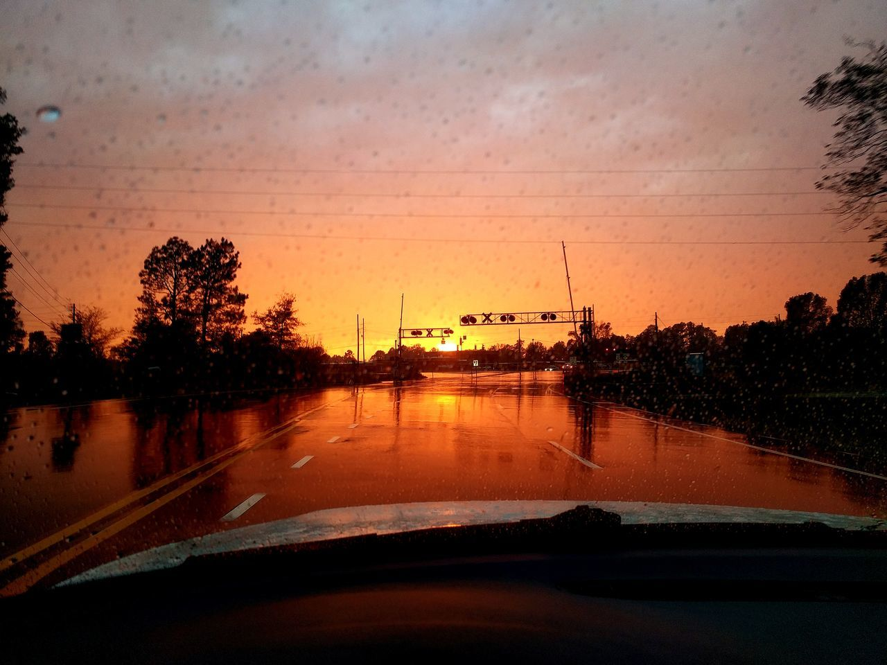 Reflections Roadway Rail Crossing Raindrops at Sunset Intersection Views Drivebyphotography