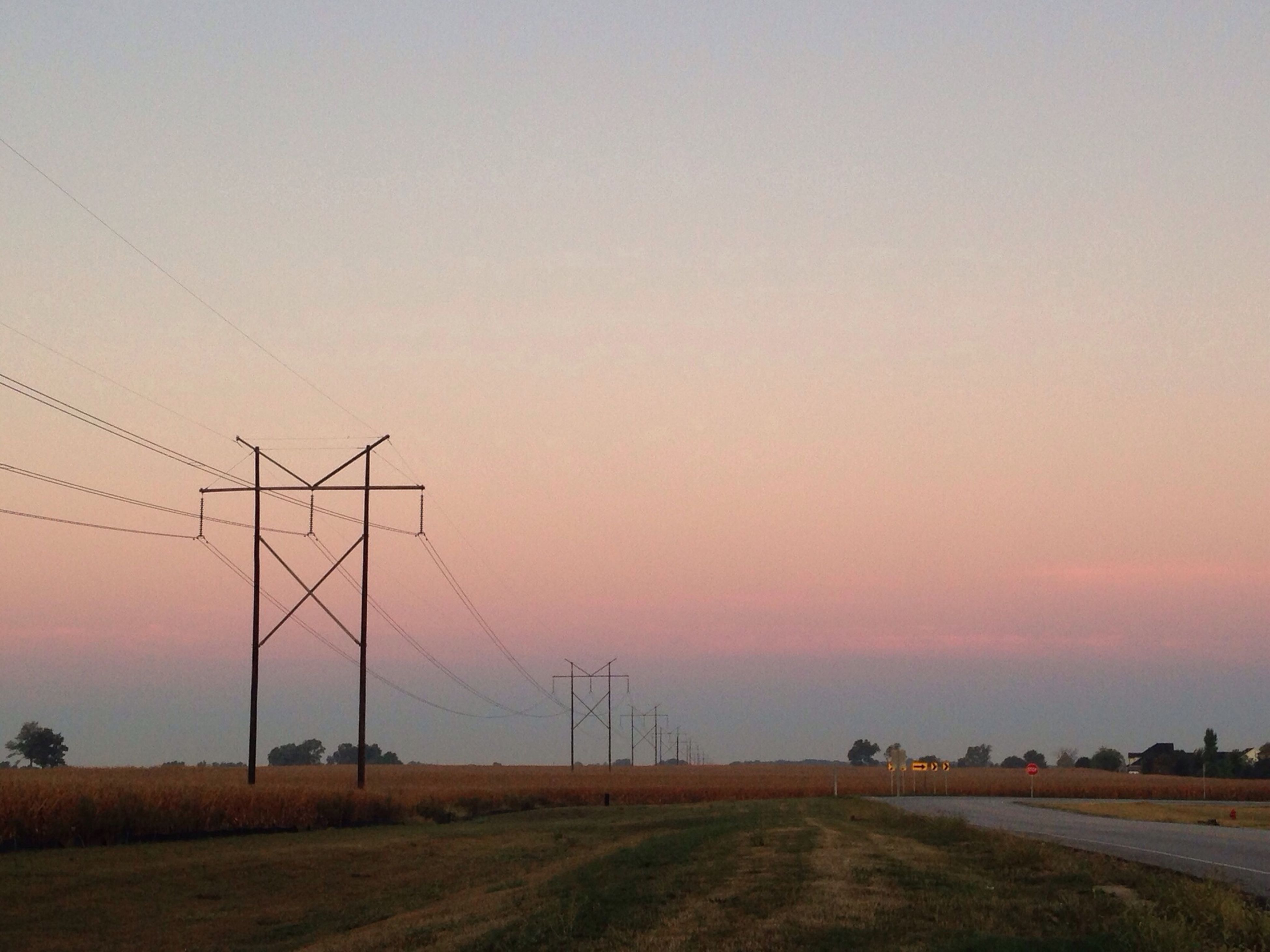 fuel and power generation, electricity pylon, landscape, sunset, clear sky, field, power line, copy space, electricity, tranquility, tranquil scene, rural scene, power supply, wind turbine, connection, road, alternative energy, wind power, sky, nature