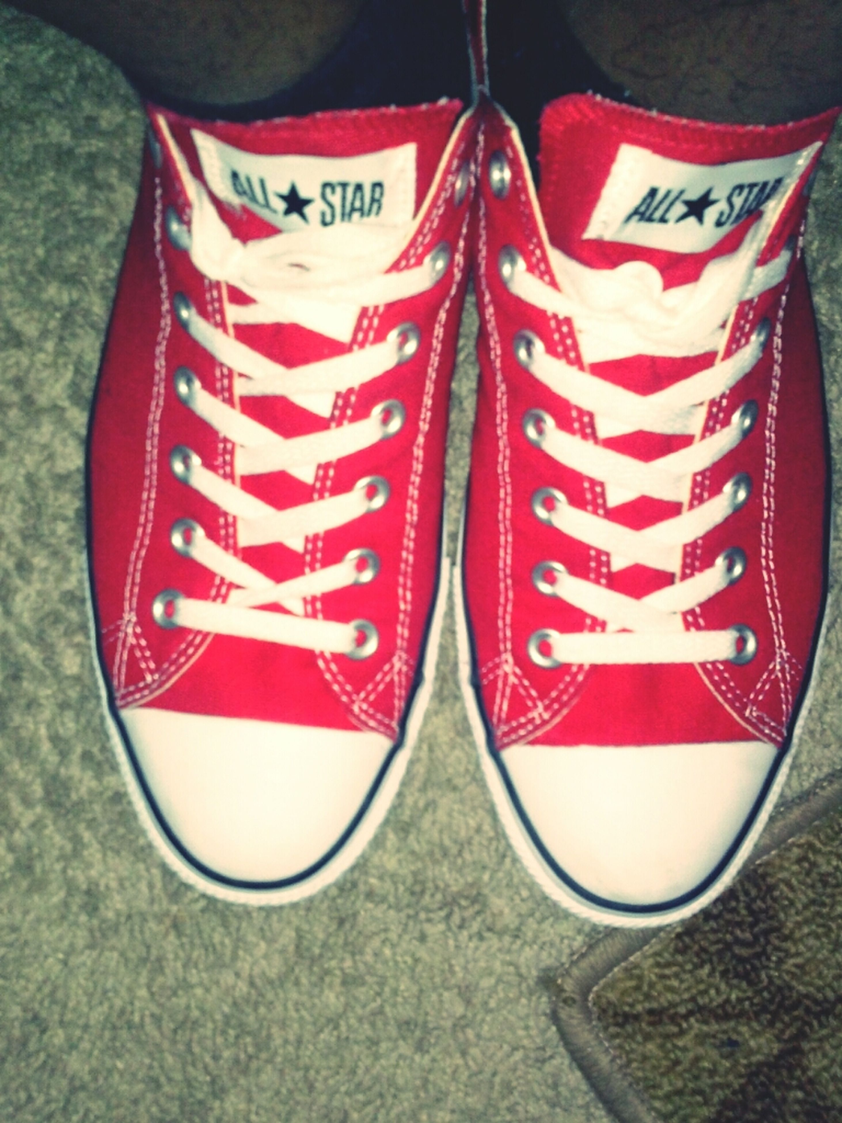 red, shoe, text, close-up, western script, high angle view, indoors, footwear, low section, canvas shoe, patriotism, communication, still life, white color, person, pair, standing, choice, day, directly above