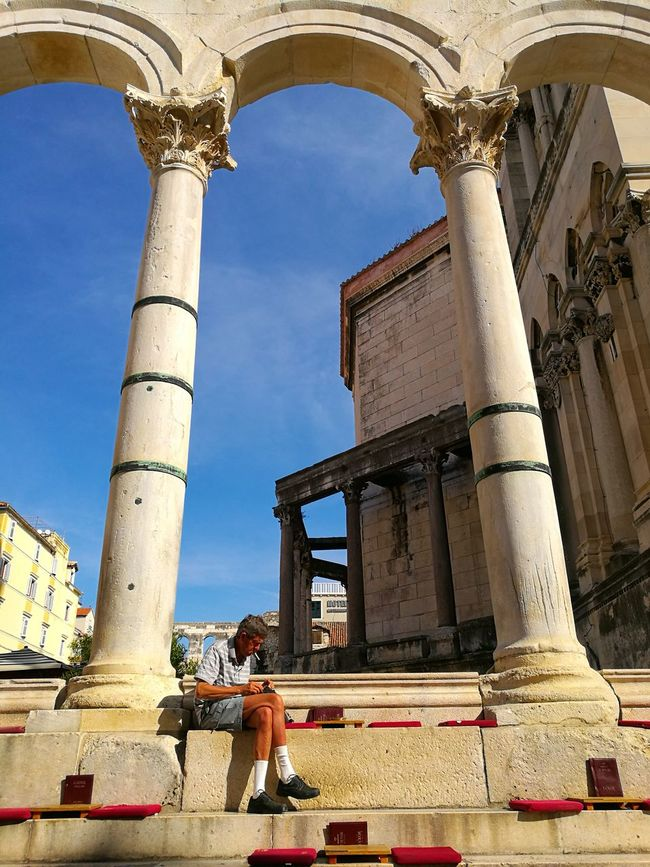 Waiting for my coffee Architecture Built Structure Low Angle View Architectural Column Building Exterior Blue Column Pillar Day Sunny Outdoors Tall - High History Sky man Old Man sitting Old Man Sitting Person Old Person Old Person Sitting