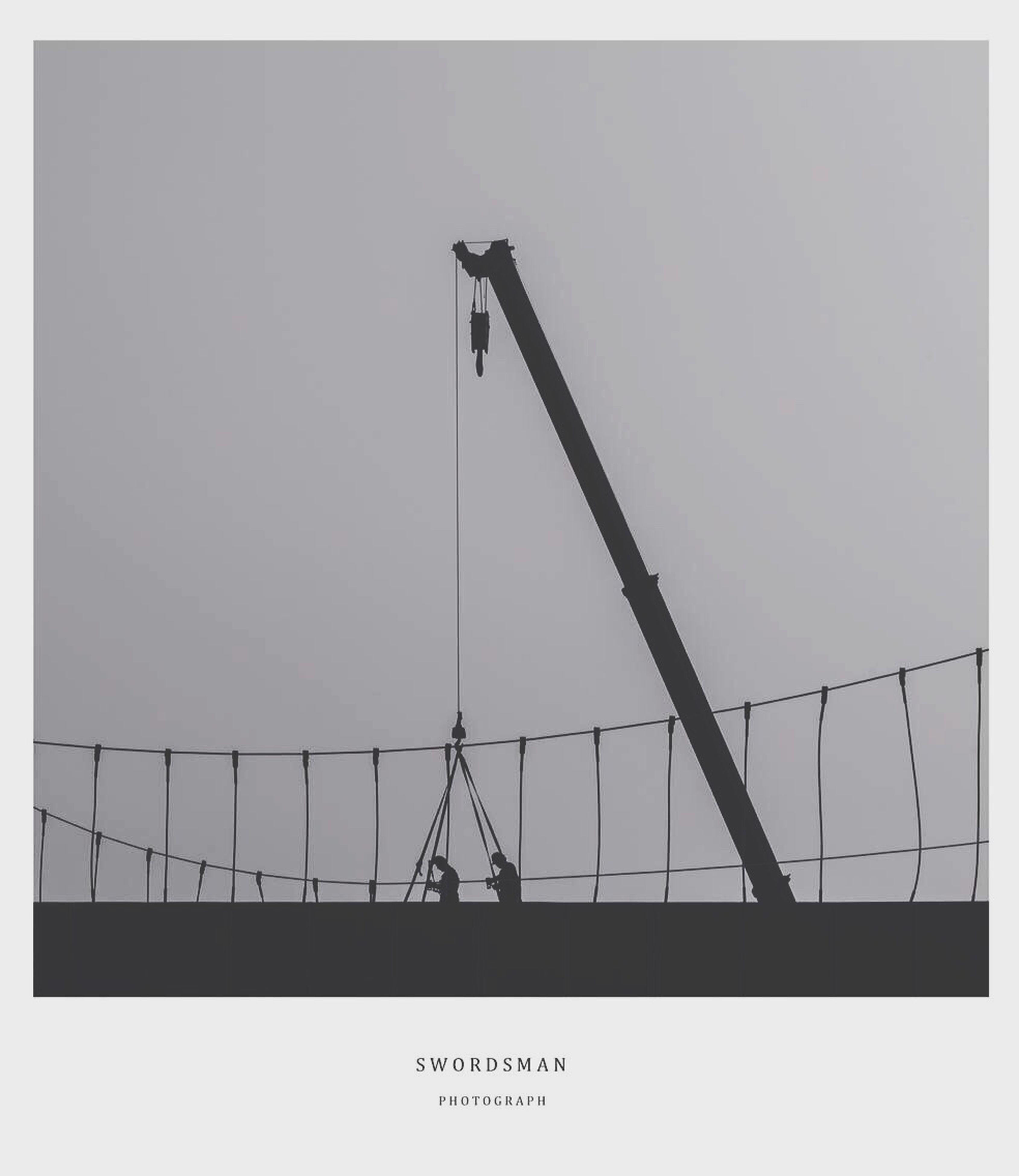 transfer print, auto post production filter, built structure, low angle view, architecture, construction site, clear sky, industry, copy space, crane - construction machinery, building exterior, technology, sky, fuel and power generation, construction, connection, development, outdoors, day, no people