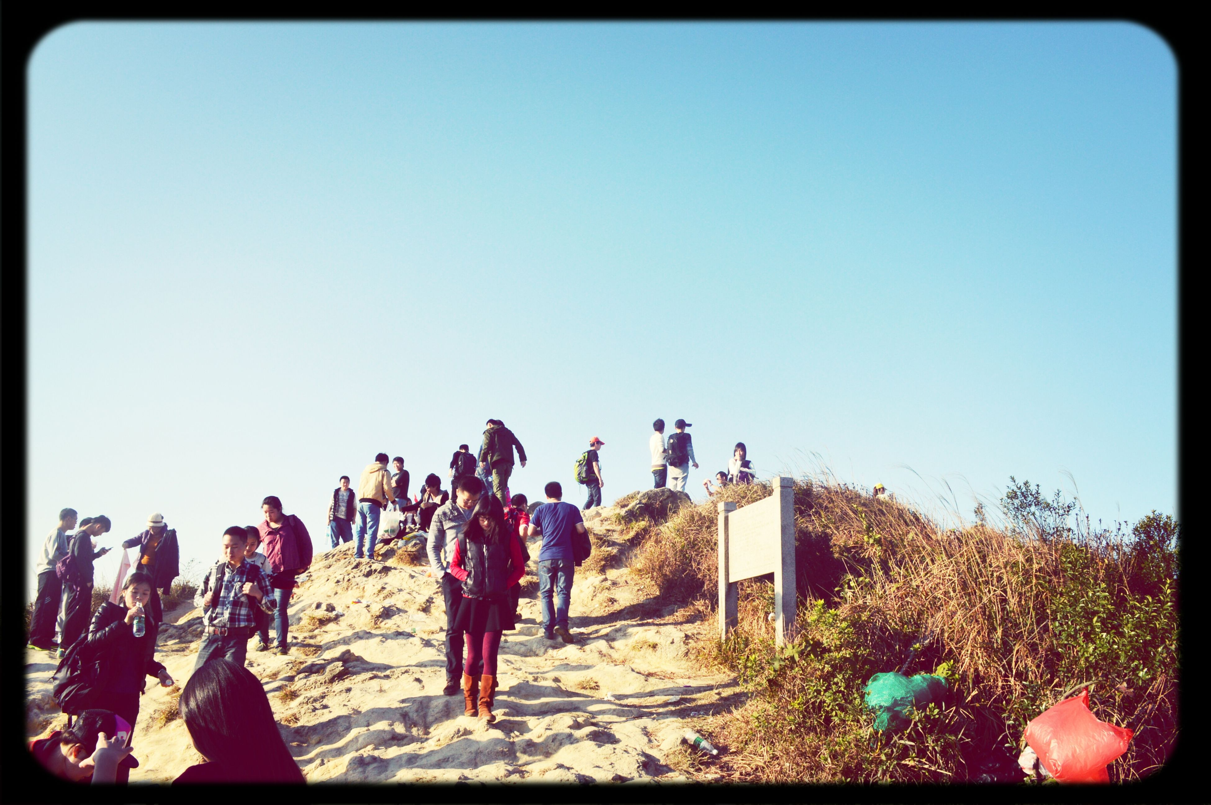 clear sky, large group of people, men, lifestyles, copy space, leisure activity, person, transfer print, mixed age range, walking, auto post production filter, togetherness, enjoyment, tourist, blue, full length, vacations, group of people, medium group of people
