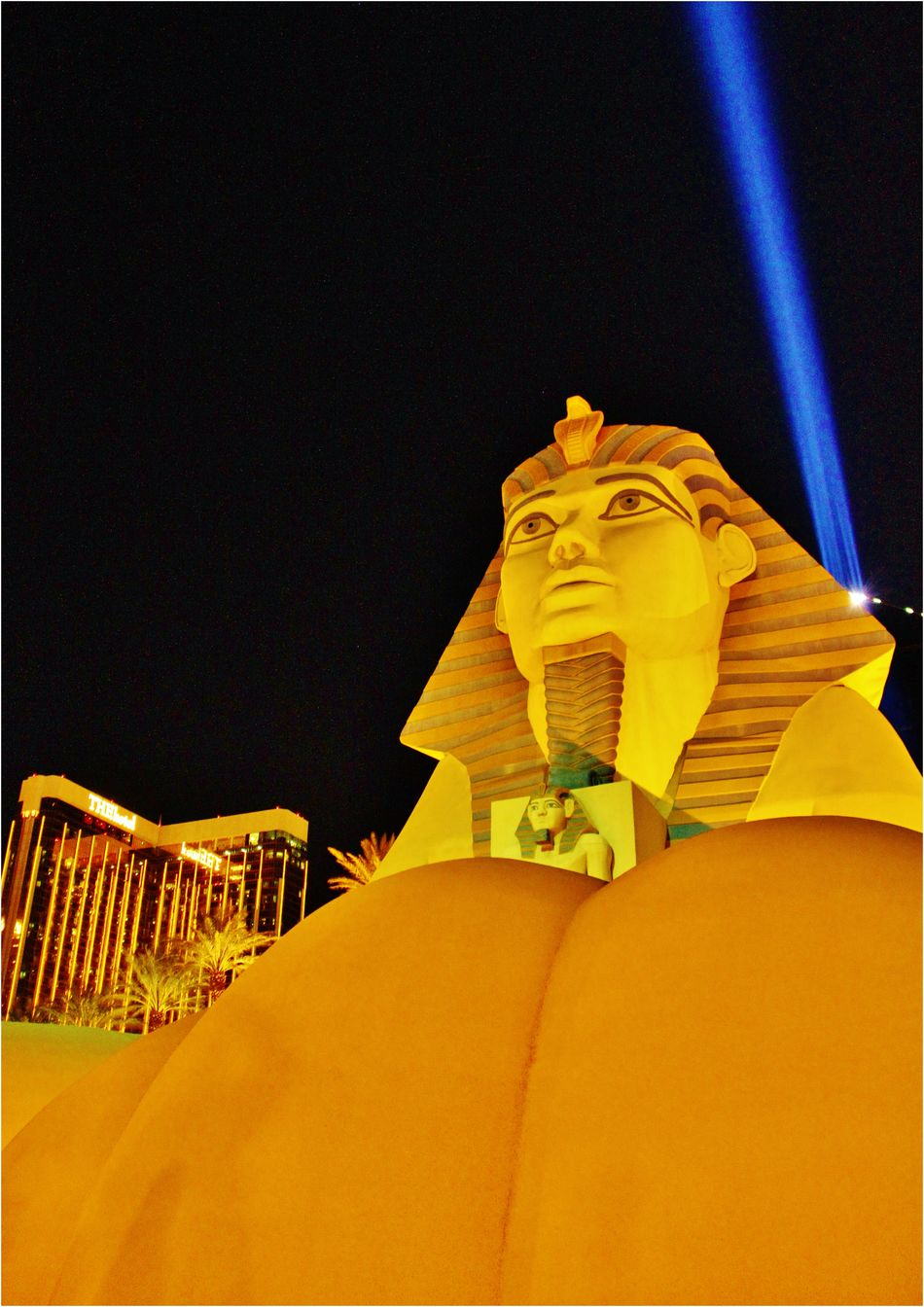 Luxor Las Vegas a replica of the Great Sphinx of Giza and a pyramid shaped building with a spotlight. America Attractions Baccarat Black Jack Bugsy Siegel Elvis Presley Frank Sinatra Giza Las Vegas Laserbeam Lighting Up The Night... Luxor Poker Portrait Of America Pyramid Sphinx Travel Photography Trip United States USA Videokino Yellow