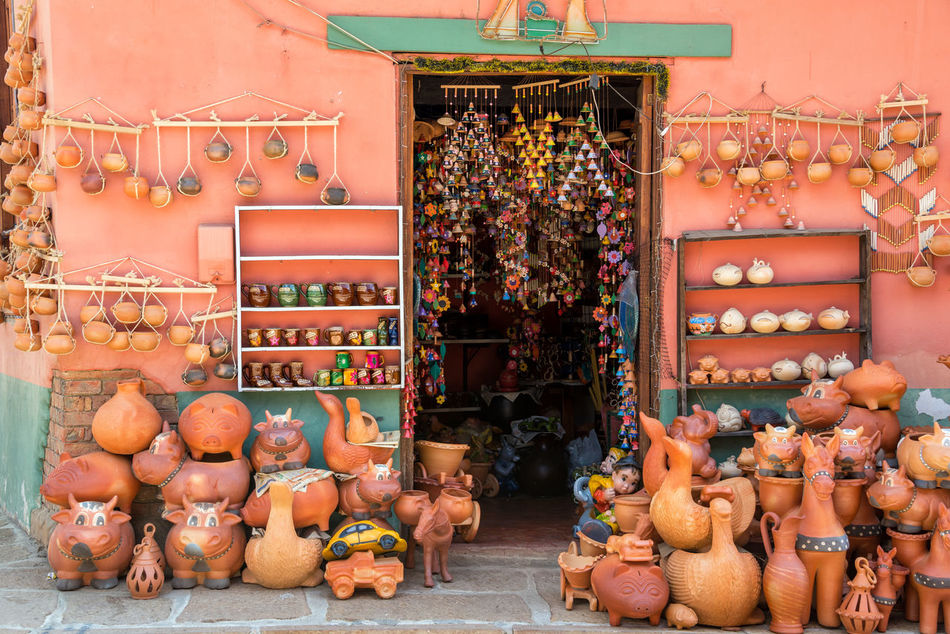 Typical souvenirs for sale in a shop in Raquira in Boyaca, Colombia Architecture Art Boyaca Colombia Colombian  Colonial Culture Day Latin Market Outdoors Raquira Sale Sell Shelf Shop Souvenir Souvenirs Store Street Tourism Town Travel Typical VillaDeLeyva