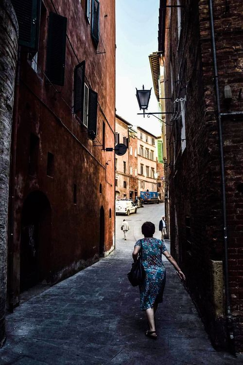 Architecture Built Structure Building Exterior The Way Forward Full Length Lifestyles Street Leisure Activity Walking Residential Structure Residential Building City Casual Clothing Vanishing Point Diminishing Perspective Narrow Day Outdoors Alley Sky