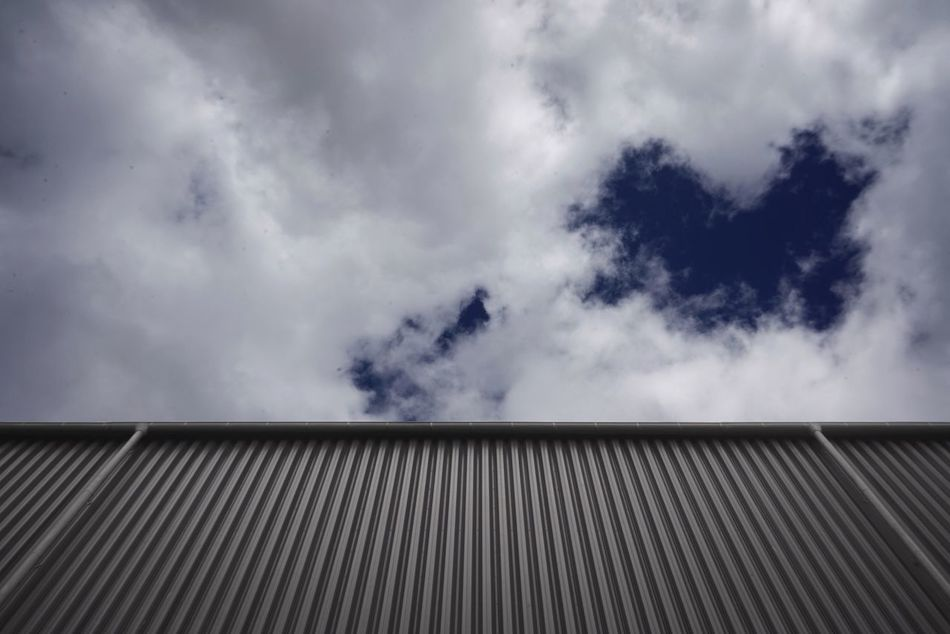 Cloud - Sky Sky Outdoors Day No People Architecture Building Exterior Low Angle View Built Structure Nature Corrugated Iron
