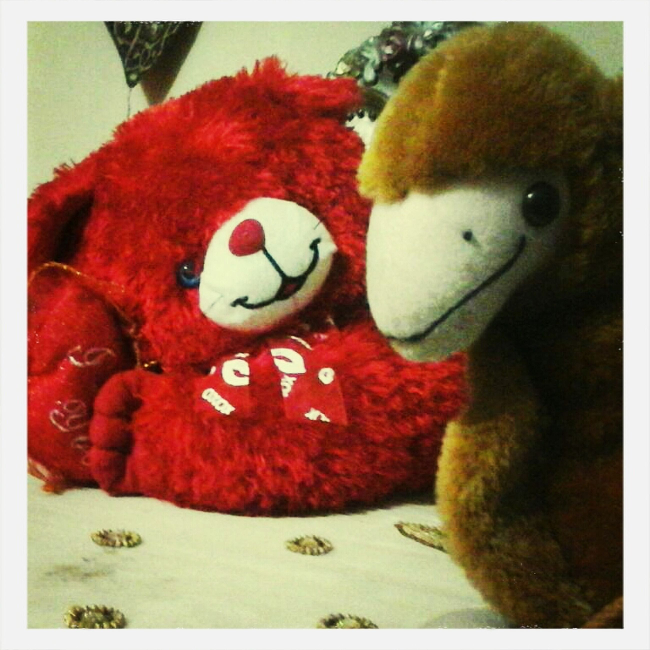 transfer print, auto post production filter, indoors, toy, animal representation, still life, close-up, high angle view, stuffed toy, food, table, red, food and drink, no people, childhood, humor, teddy bear, animal themes, sweet food, day