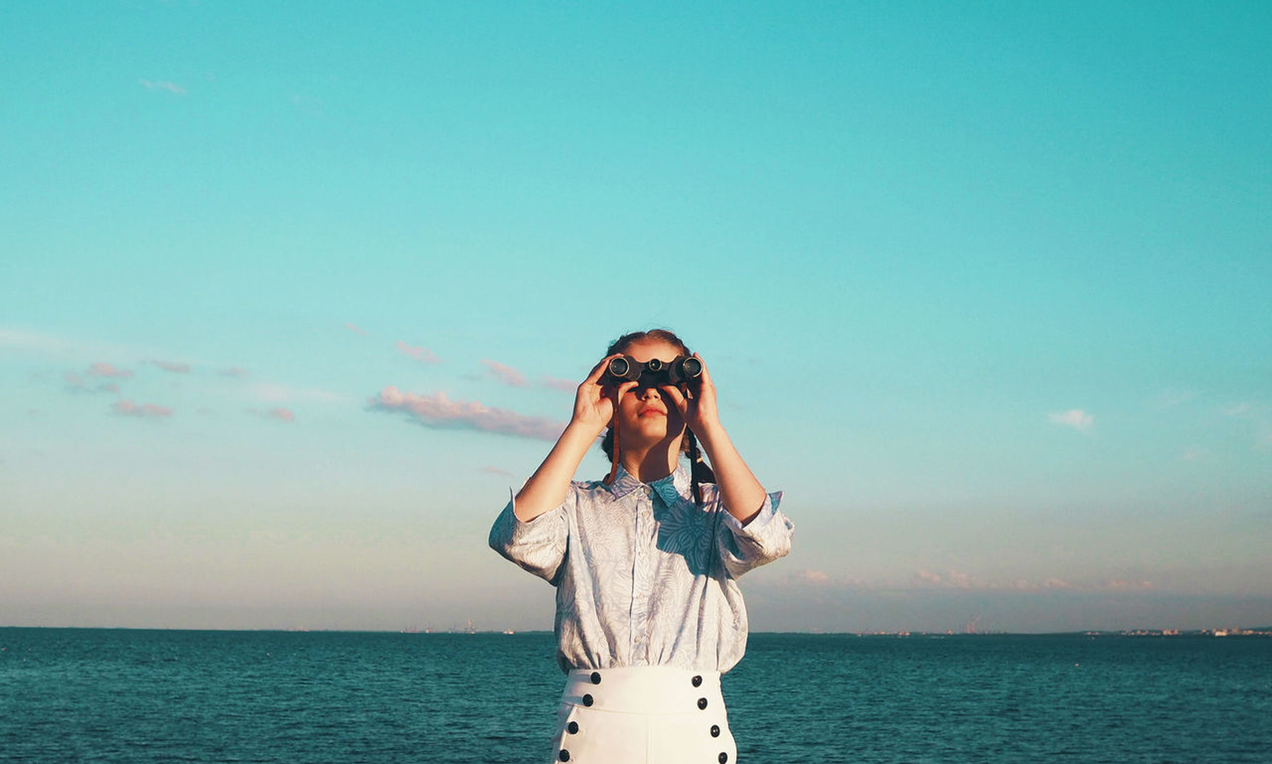 real people, front view, standing, sea, waist up, sky, one person, young adult, horizon over water, leisure activity, lifestyles, portrait, beauty in nature, looking at camera, young women, scenics, nature, outdoors, day, water, adult, people