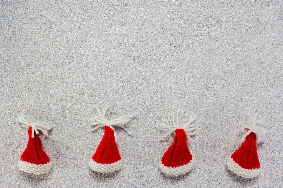 A colorful christmas tree and red christmas hats on white snow Background Cap Celebration Christmas Claus December Decoration Festive Holiday Merry Santa Sky Snow White Winter Xmas