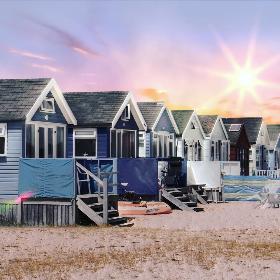 Beach Huts Built Structure Architecture Beach Building Exterior In A Row House Sand Sky No People Outdoors Sun Sunlight Sunset Sea Multi Colored Day Nature
