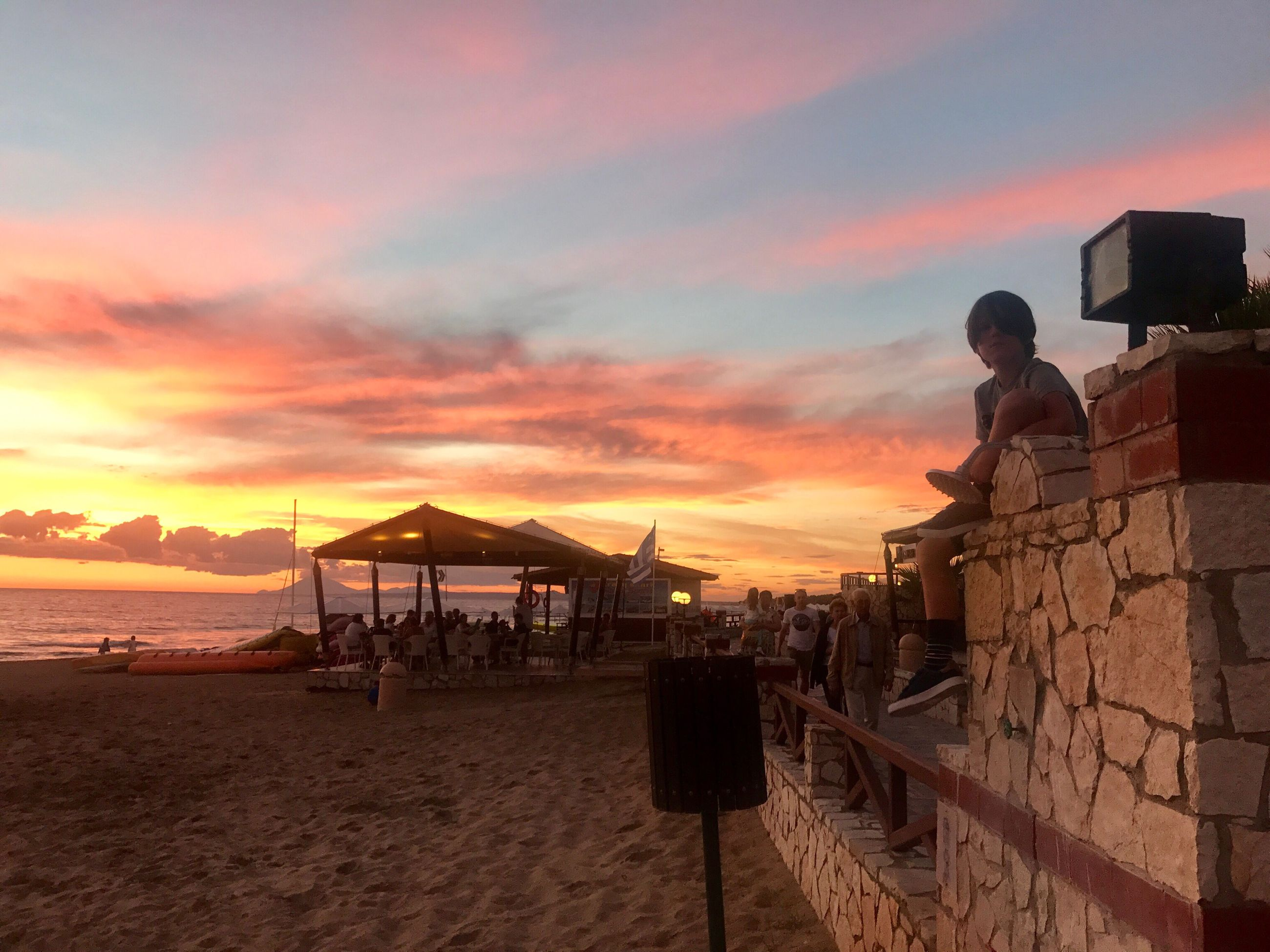 sunset, beach, sand, sea, nature, real people, sky, orange color, beauty in nature, outdoors, tranquil scene, tranquility, cloud - sky, scenics, vacations, leisure activity, lifestyles, one person, men, water, architecture, horizon over water, day, people