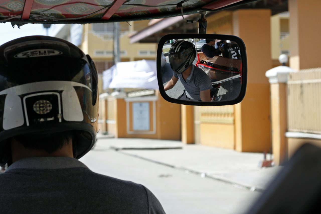 Adult Adults Only Cambodia Tour Cockpit Day Eyeglasses  Indoors  Mode Of Transport One Man Only One Person Only Men People Phnom Phnompenh Tuk Tuk Tuk Tuk Cambodia Tuk Tuk Driver Tuk Tuk In Phnompenh Tuk Tuk Thailand TukTuk