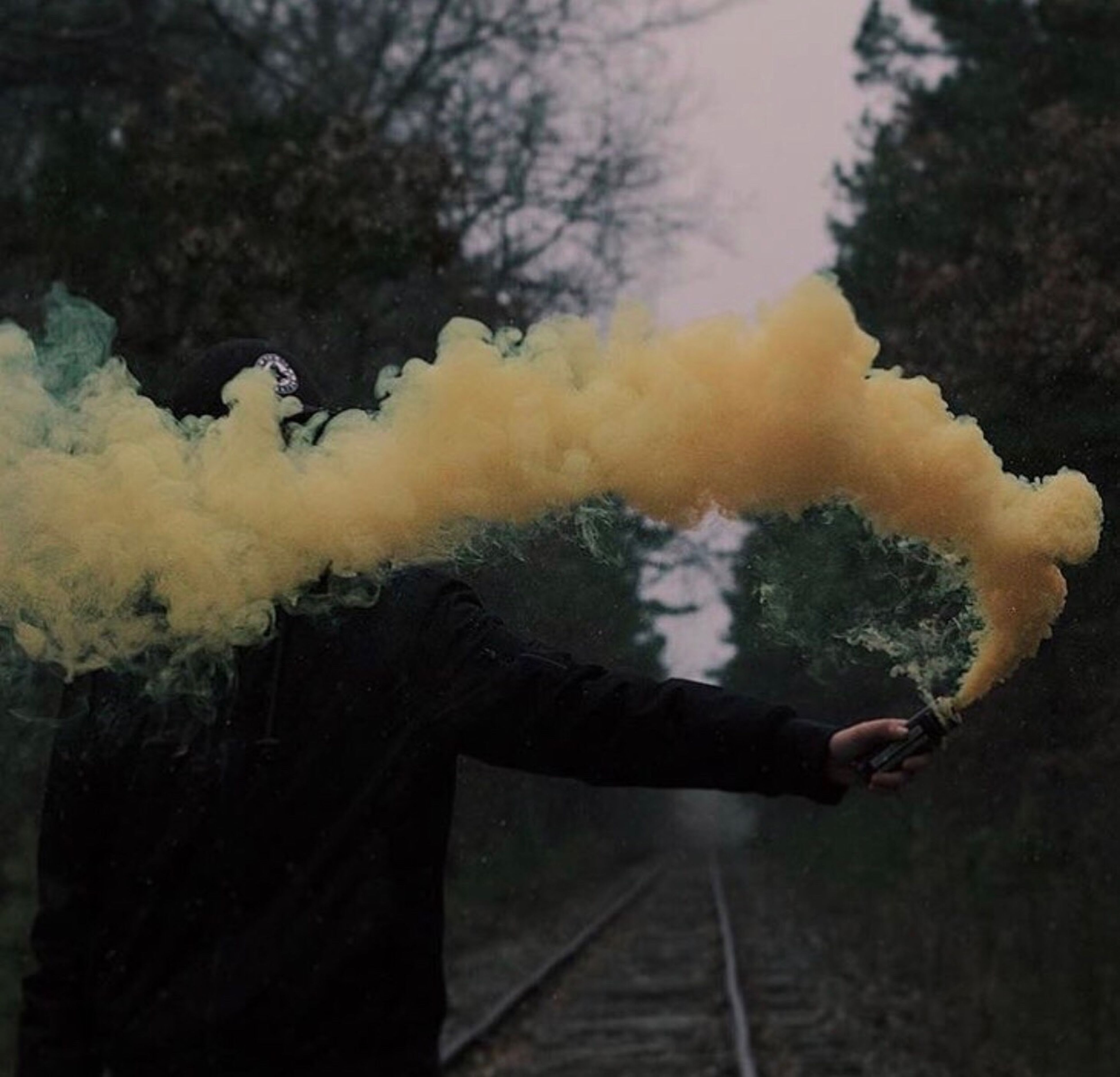 smoke - physical structure, real people, one person, men, outdoors, leisure activity, burning, day, lifestyles, human hand, human body part, one man only, water, nature, close-up, sky, people