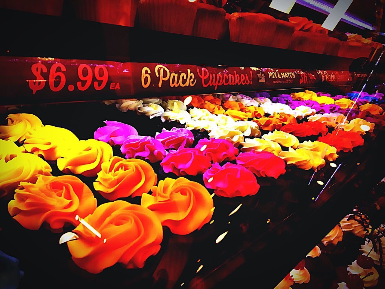 retail, variation, choice, flower, for sale, multi colored, text, large group of objects, arrangement, abundance, market, no people, store, indoors, flower market, night, hanging, fragility, freshness, price tag, flower shop, beauty in nature, flower head, close-up
