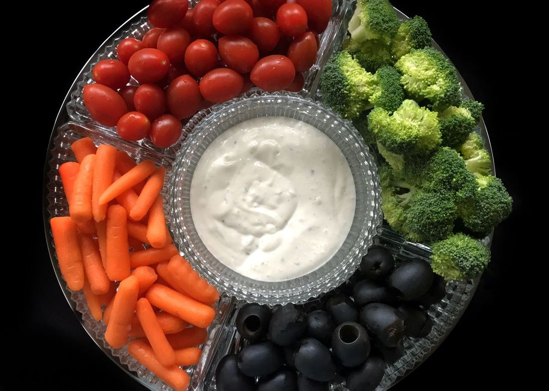 Vegetable tray. Vegetable Tray Vegetable Broccoli Black Olives Baby Carrots Grape Tomatoes Tomatoes Carrots Healthy Eating Raw Food Ranch Dressing Freshness Directly Above Black Background Close-up Ready-to-eat Horizontal Food Stories